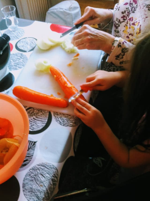 Child cutting carrots